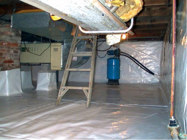 our durable crawl space liner installed on the walls and floors of a stone foundation basement