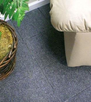 Basement floor tiles installed on a concrete slab floor.