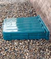 Our lockable crawl space door system installed in a garden