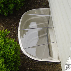 A covered basement window well system