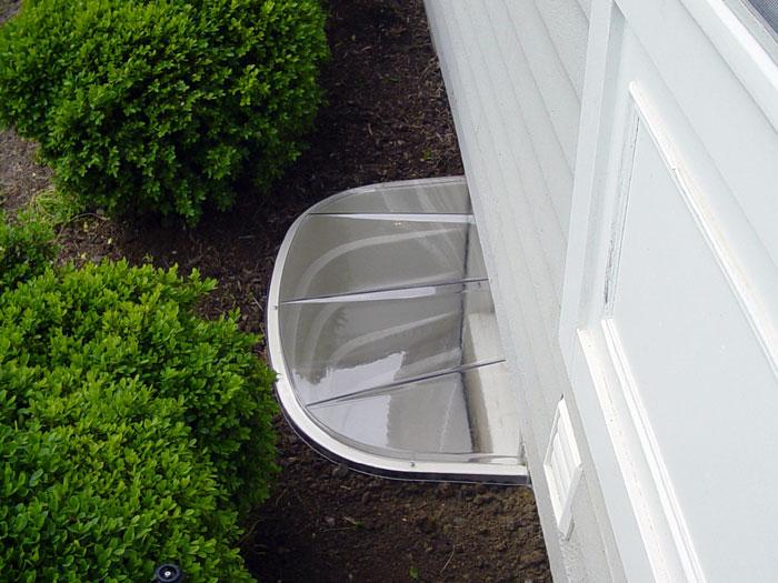 basement window well ideas. Our Basement Window Well System Installed Along A Shrubbery Garden. Ideas