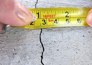 measurement of a crack in a concrete wall