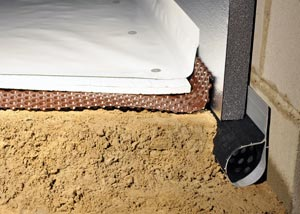 A sealed, waterproofed, and insulated crawl space with drain system.