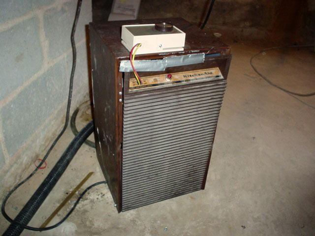 an old broken basement dehumidifier that 39 s been cobbled back together