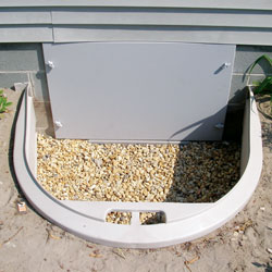 A crawl space access door and access well