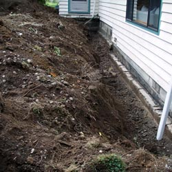 Exterior excavation of a basement to install a perimeter French drain system