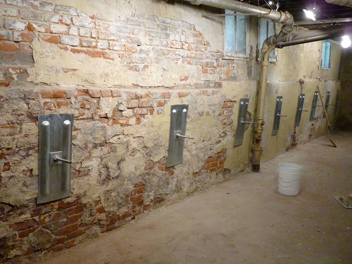 how to fix a basement wall that is caving in