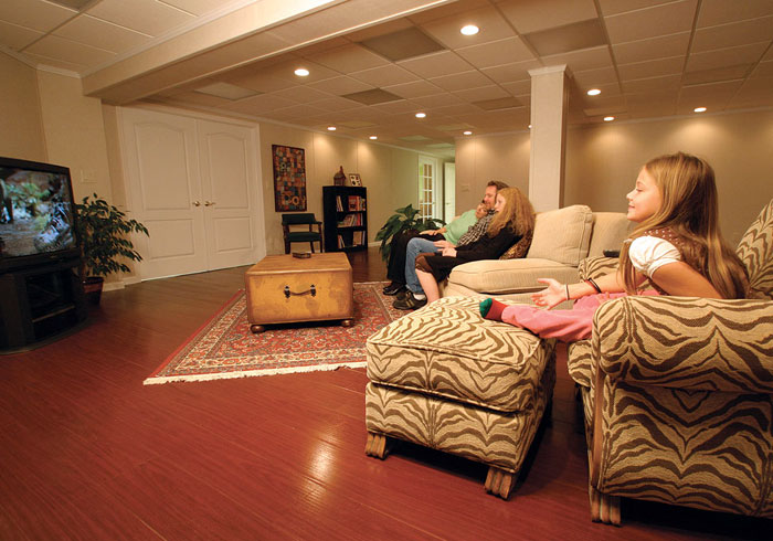 A Family Room With Our Wood Flooring System Installed. The Floor Is  Finished With MillCreek