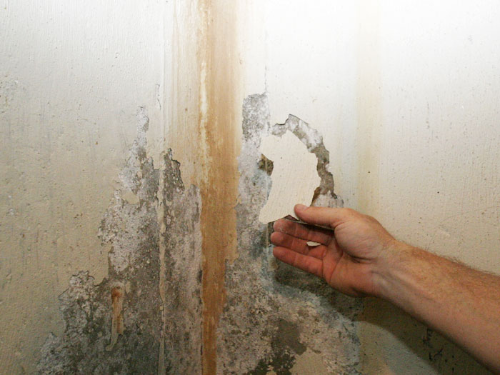 Reasons To Use The Water Sealant Paint For Basement ... ugly, water-stained waterproof coatings on a basement wall, Three  layers of failed basement waterproofing paint ...