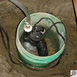 A sump pump installed in a small five gallon bucket.