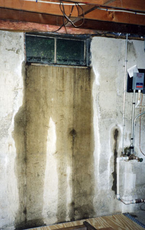 stains and water on a concrete wall from a leaking window