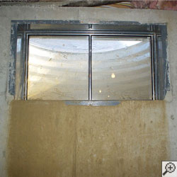 A basement that's flooding through the windows.