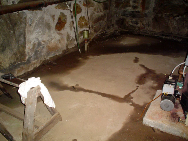 ... Multiple Cracks In A Basement Floor That Are Leaking