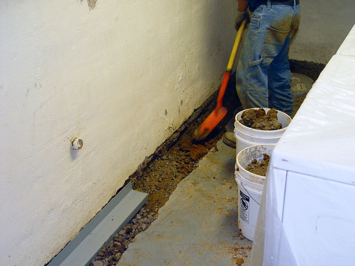 Foundation Drain System : Our complete foundation drain system installing a