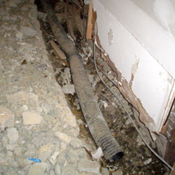 A do it yourself basement drain system installation in progress