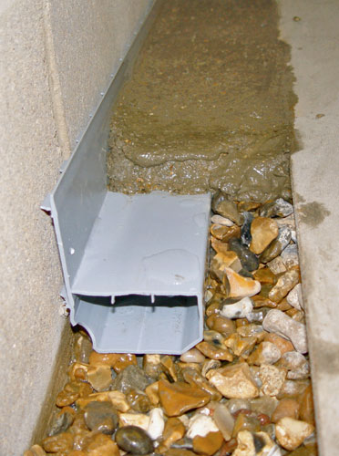 ... A French Drain System Installed Along The Perimeter Of A Basement Floor.