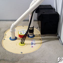 A sump pump system, complete with perimeter drain, Zoeller pump, airtight liner, battery backup and sump pump alarm.