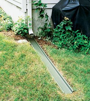 The Rainchute Downspout Extension Gutter System
