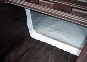 A crawl space door and crawl space vapor barrier integrated together.