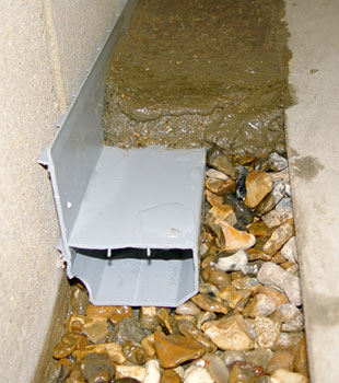 A basement drain system installed in a home