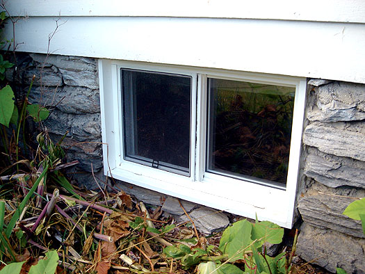 vinyl basement window with energy efficient glass installed in a