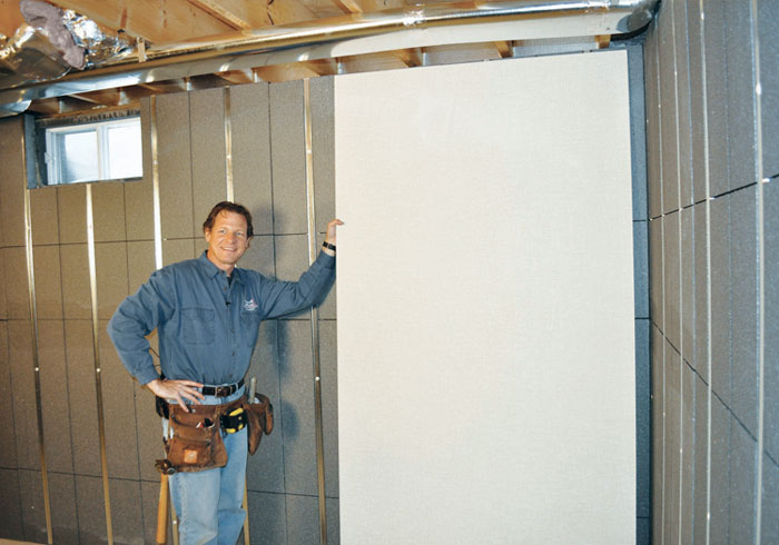 installing wall paneling on studs and insulation in a basement