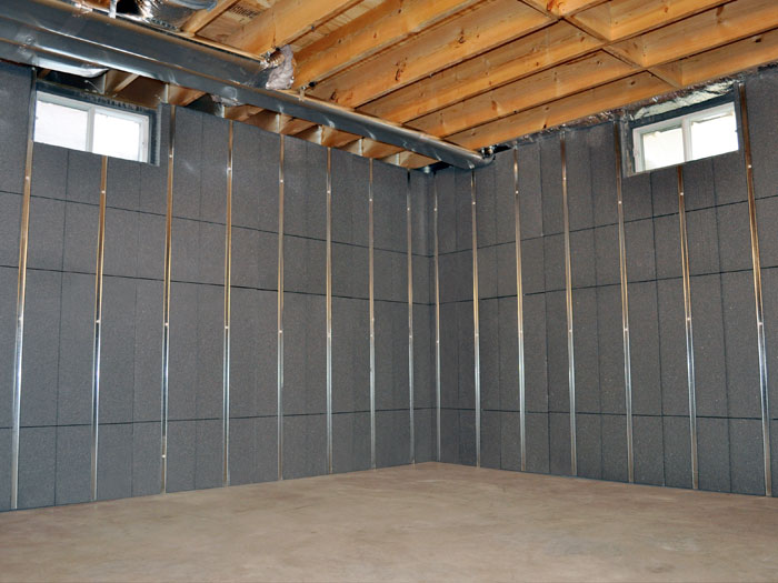 Basement walls that have studs and insulation installed on them. & Our Basement Wall Products