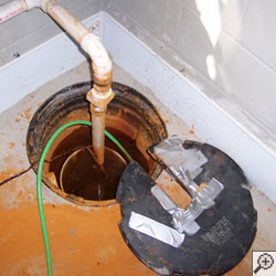 A sump pump system clogged with iron ochre