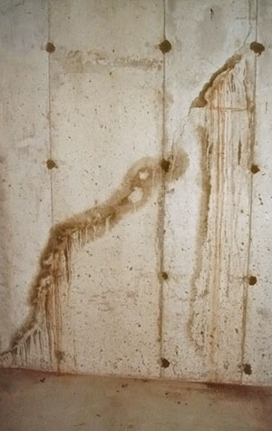 severe leaking through a basement wall crack - Crack In Basement Wall