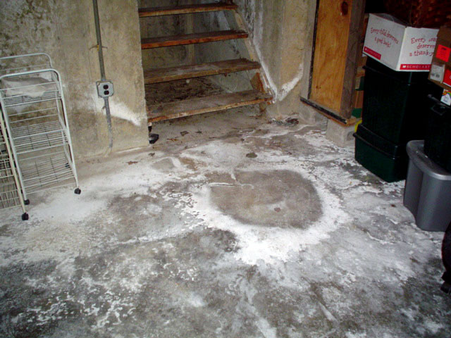 groundwater entering a basement through cracks in the basement floor
