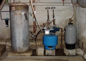 Several models of water heater installed in an old basement