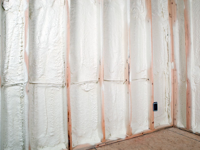 Open Cell Spray Foam Insulation Installed To Finish A Basement.