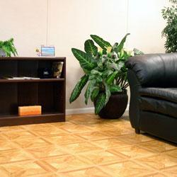 waterproof basement flooring tiles in a parquet design.