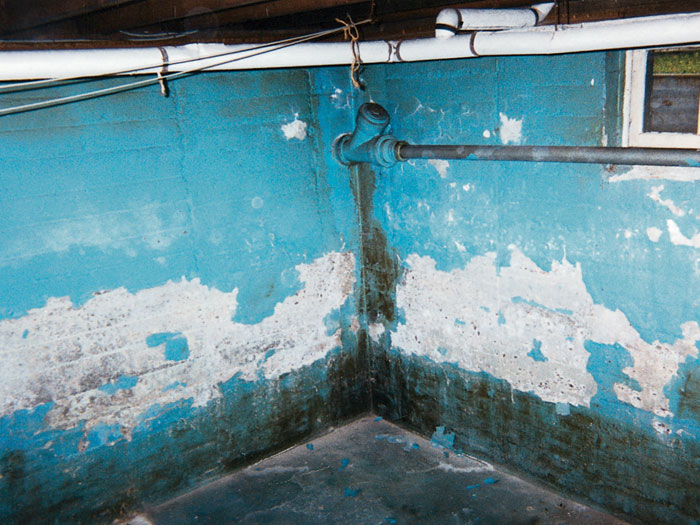 Reasons To Use The Water Sealant Paint For Basement A basement with bright blue waterproof paint that is heavily peeling and  flaking off the walls