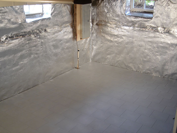 A Basement With A Radiant Heat Barrier And Vapor Barrier On The Walls, And A