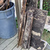 Mold-damaged wood being piled outside of the home on a porch.