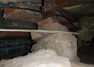 Failing supports in a crawl space.