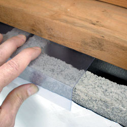 A clear plastic wall sealing system for block wall foundations in crawl spaces