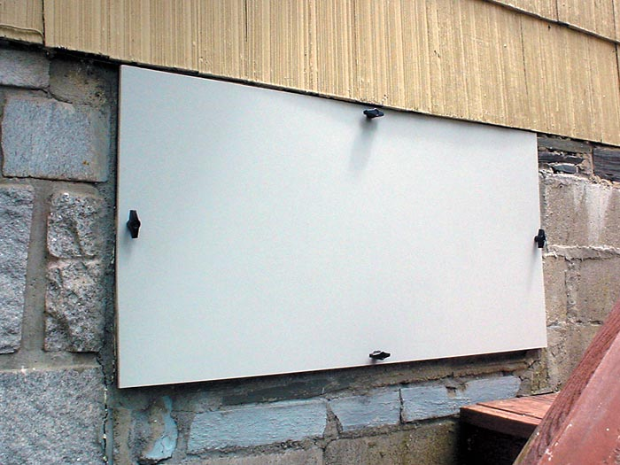 An Installed Crawlspace Door System On A Home ...