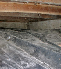 a barrier system installed on the floor of a short crawl space