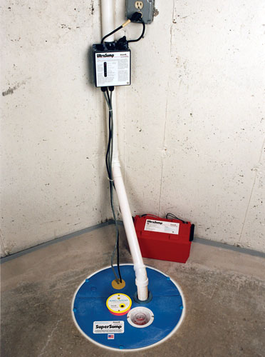 sump pump and battery backup sump pump installed in a cellar