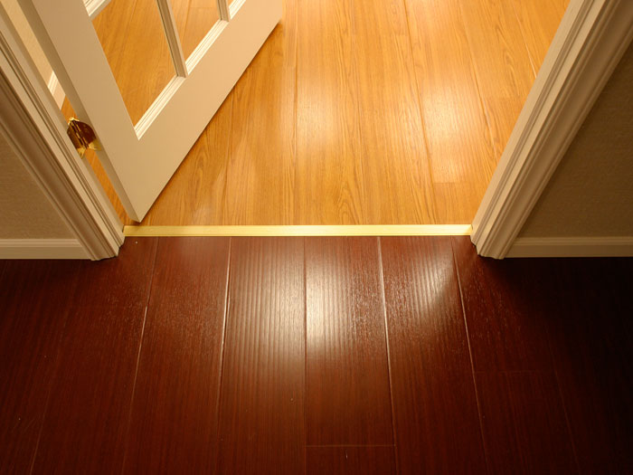 Synthetic wood flooring installed on a concrete basement floor & Our Basement Flooring Options