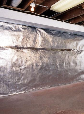 A radiant heat barrier installed on concrete basement walls.