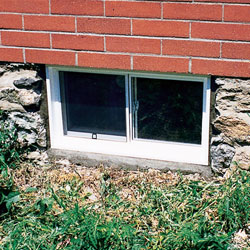 Outside view of a vinyl basement window system