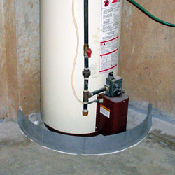 A sump pump liner set in place in a basement floor during the installation process.