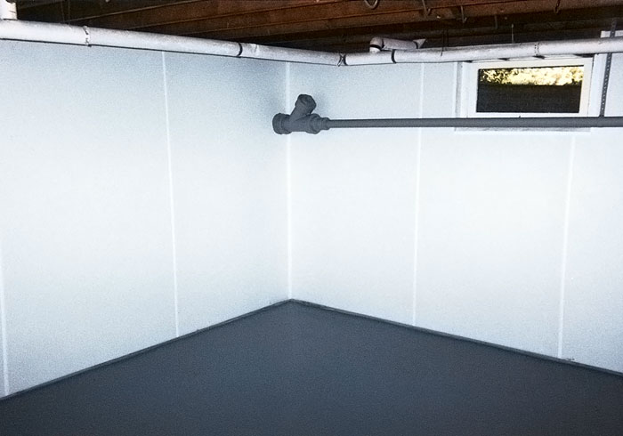 bright white plastic basement wall panels installed on concrete foundation walls