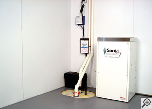 A dry basement with sump pump, dehumidifier, subfloor tiles, and basement wall panels installed
