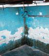 Failing waterproof paints and coatings on a basement wall