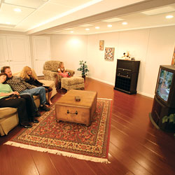 Wood laminate basement flooring installed in a finished entertainment area.