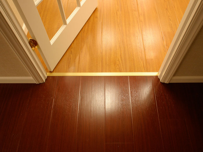 Wood laminate flooring installed on a basement floor. & Rotting Basement Floors | Basement Flooring Damaged By Rot Mold ...
